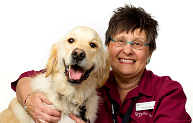 Photo of a Caring Canines volunteer and her dog