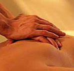 Hands massaging a person's abdomen
