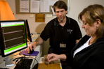 Occupational therapist teaches patient biofeedback