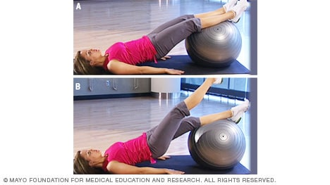Photo of woman doing bridge on fitness ball