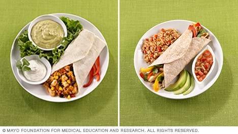 Photo of healthier burrito with sides of salsa, fresh avocado and rice