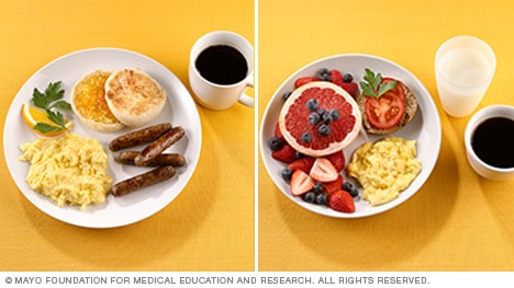 Photo of eggs, grapefruit, mixed berries and a whole-wheat bagel