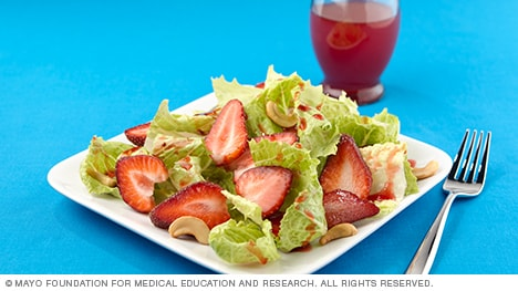 Photo showing romaine and strawberry salad