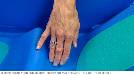 Photo of hand testing water temperature