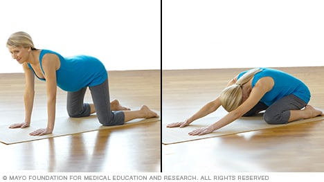 Pregnancy stretches — pregnant woman practicing backward stretch