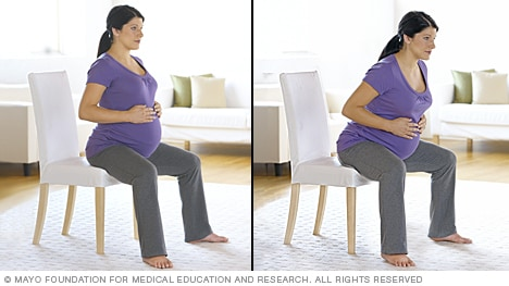 Woman in labor rocking while seated