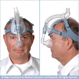 Photos of CPAP mask with nasal pillows and ball-cap-style straps