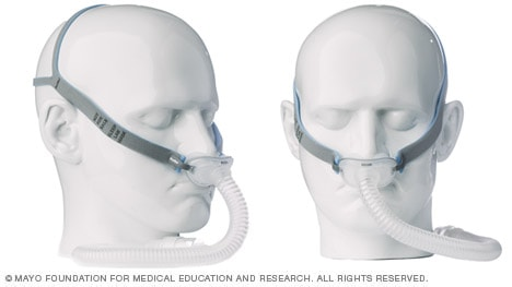 Photos of CPAP mask with nasal pillows and side straps