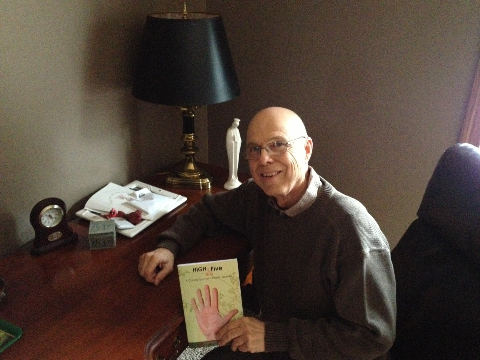 Dr. J. Campbell with book