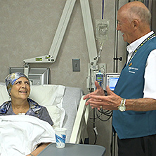 Photo of Mayo Clinic volunteer at a patient bedside