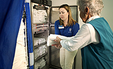 Photo of Mayo Clinic volunteer stocking linens