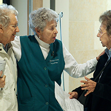 Photo of Mayo Clinic volunteer talking with patients
