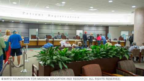 Patients and family at registration desk — Mayo Clinic's campus in Florida