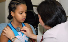 A physician examines a young patient