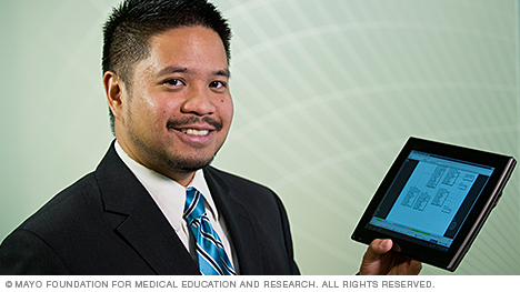 Mayo Clinic information technology staff member holding a tablet